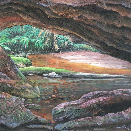 A realistic look out of a cave  and a waterhole that you can see into. The cave walls are textured with sand and give a 3 D look.