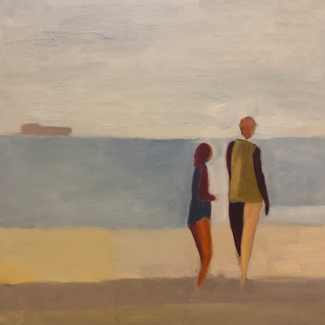 Two figures on an expanse of beach