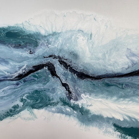 Acrylic pour in blues and white on a large canvas