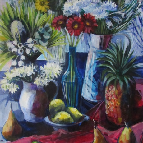 2 white jugs containing flowers, blue glass vase with red gerberas, fruit and red draping, dark blue background.