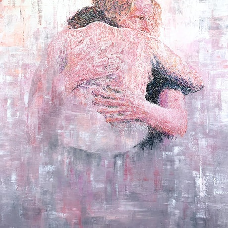 Two people embracing in a hug all painted in tint colourful dots