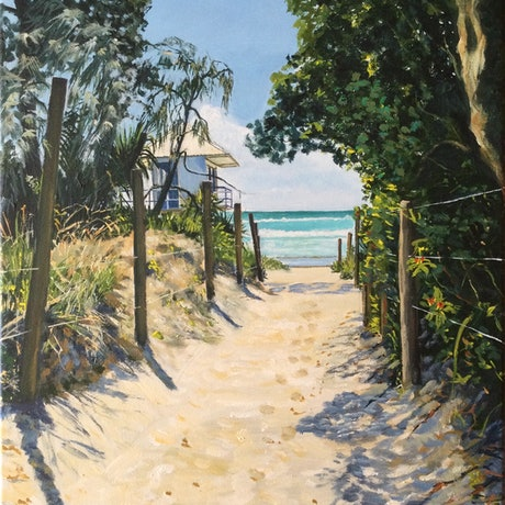 The path to the beach with footprints and a glimpse of the ocean and lifesavers lookout.