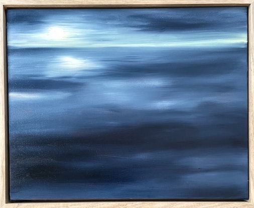 Navy sea and sky with rising moon
