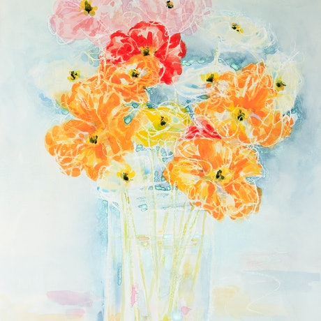 Colourful delicate Poppies in glass vase