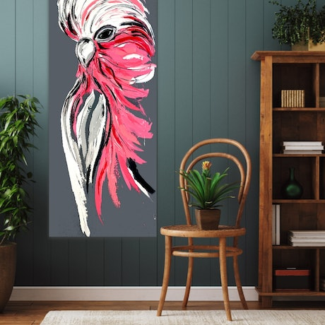 A big bold pink and  grey galah painted on a grey background