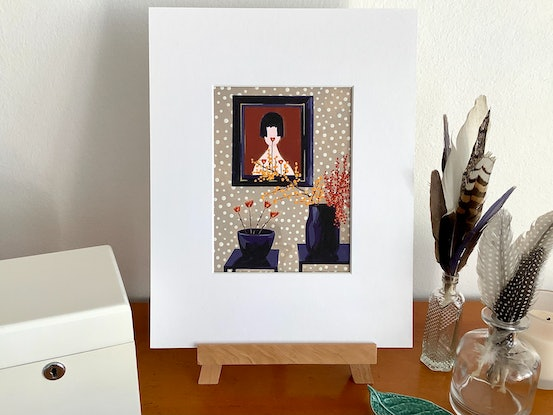 Framed picture of girl with Japanese inspired decor.
