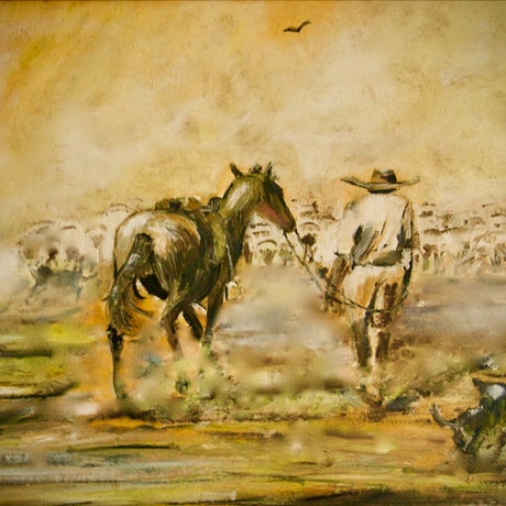 A Drover moving sheep in the dust