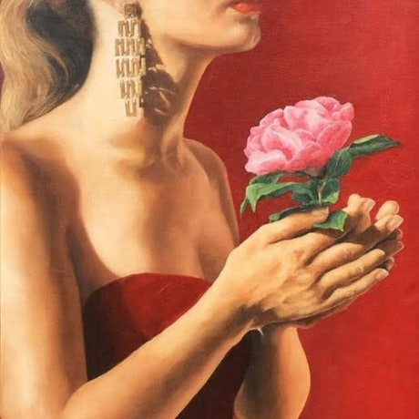 profile of beautiful girl wearing gold earrings holding a pink rose as a gift