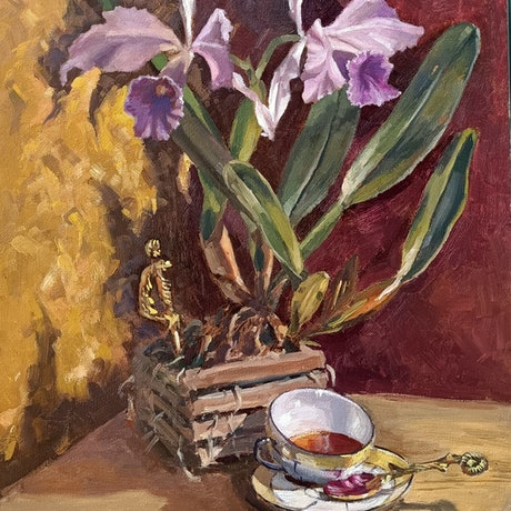 An orchid, a tipped tea cup and a  knife in a still life arrangement