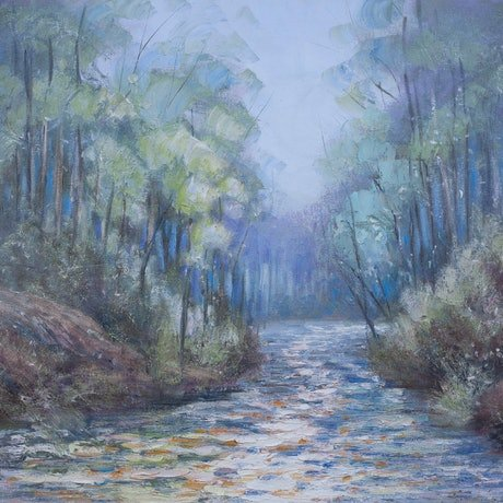 River flowing through a native forest of redgums and karri trees.