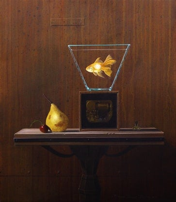 A goldfish in a bowl on a old music box with a pear