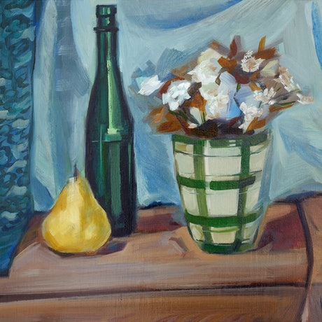 Flowers in a vase, green bottle and yellow pear against pale backdrop and lace