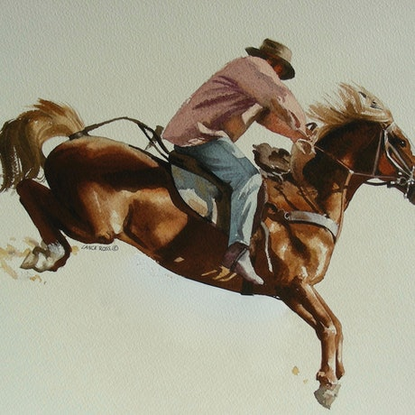 The Man from Snowy River is riding his horse downhill