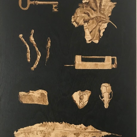 Small objects illustrated in raw umber ink on a black background
