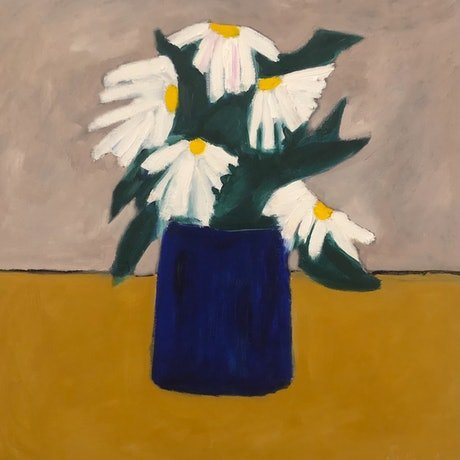 White and yellow daisies in blue vase