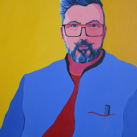 Bearded man with red glasses and lilac jacket