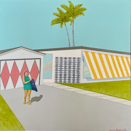 Young woman holding a lilo in front of a mid century beach house.
