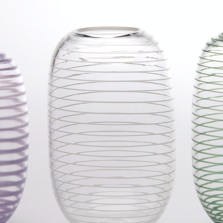 Tall, rounded clear glass vase with opaque white spiral