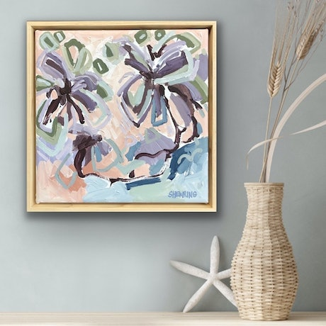 Beautiful flowers in expressive abstract style in purple, mauve, pinks, terracotta, blue and sage green on a square framed canvas.
