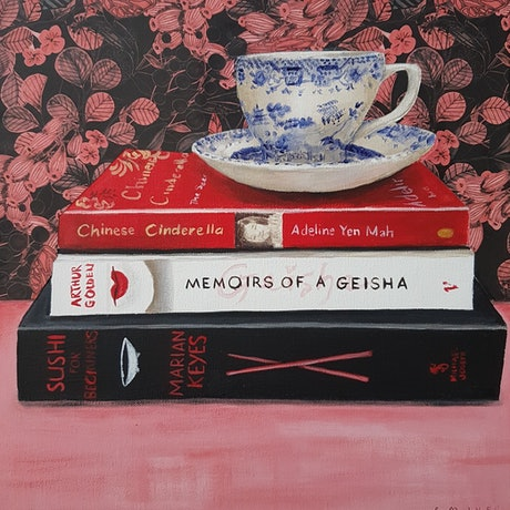 Tea cup on a pile of books
