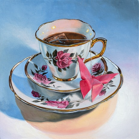 A small realistic painting of a tea cup set. The small tea cup is sitting on two levels of tea plates. The tea set is decorated with ornate pink roses. Inside the tea cup is brown colored tea with a teabag infusing in the liquid. The string from the teabag connects to a pink origami butterfly, leaning against the teacup and plates. The background shows shadows made from two light sources hitting the tea cup set, a neutral mix of blues, pinks, yellows and whites.