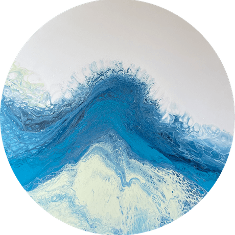 A large circle canvas with a blue, pale yellow and white acrylic pour.