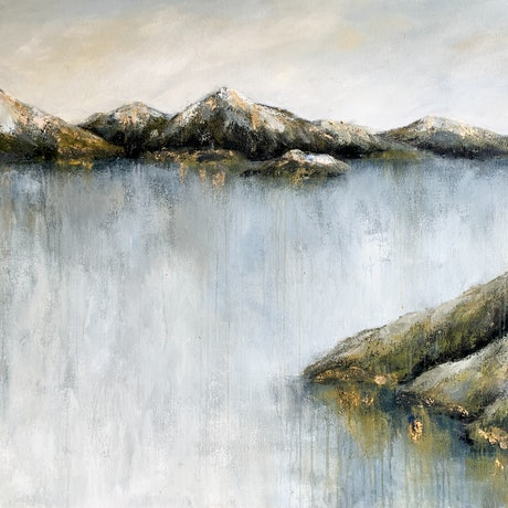 textured mountains with gold leaf highlights rising from blue green aqua water with moody pale sky