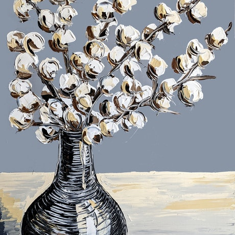 A bunch of cotton painted on a light grey background with a cream foreground. The cotton is in a textured black clay vase.