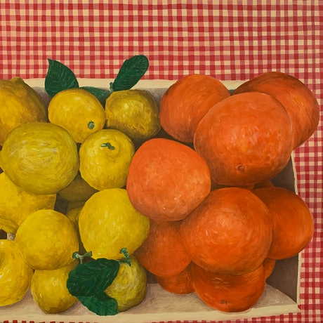 Citrus fruit box on gingham tablecloth